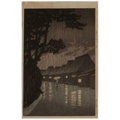 """Early 20th Century Kawase Hasui Woodblock Print """"Rainy Night at Maekawa"""""""