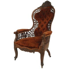 American Victorian Carved Rosewood Bergere Armchair with Filigree