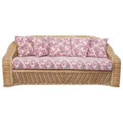 Vintage Curved Wicker Sofa Upholstered in Pink and Purple Floral Fabric