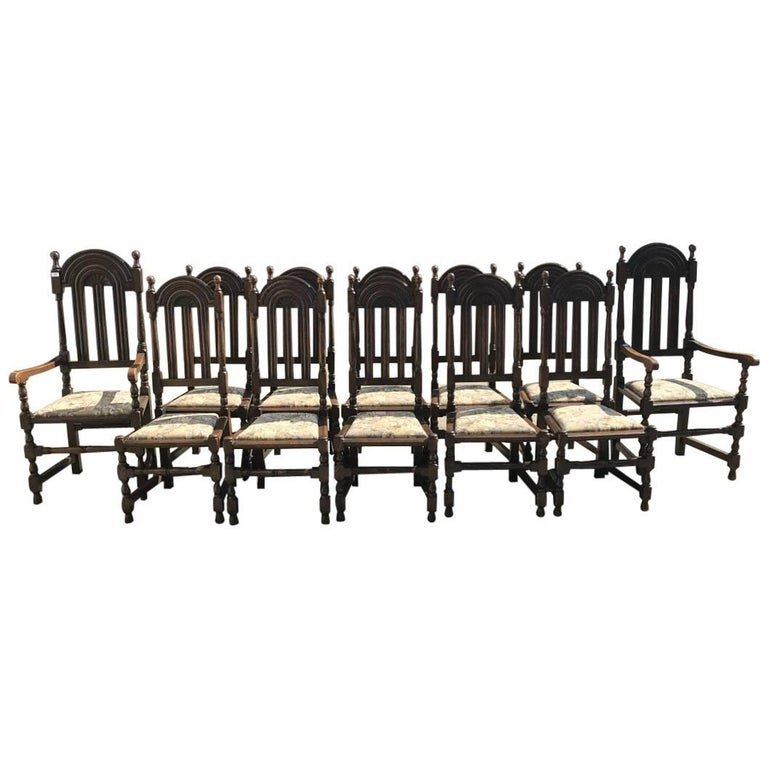 Liberty & Co. Set of 12 Gothic Style Arts & Crafts Oak Dining Chairs & Armchairs