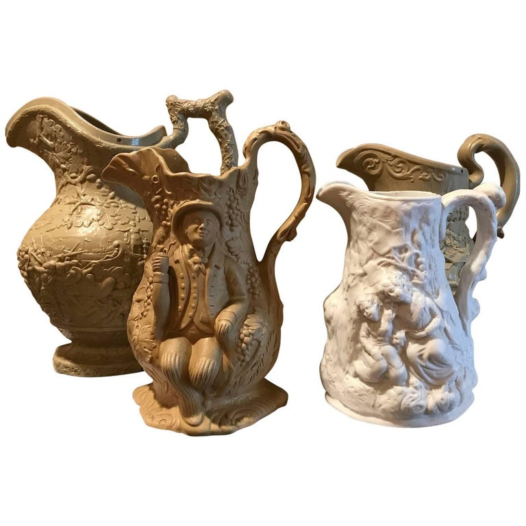 Lot of Four 19th Century Ceramic Relief Pitchers