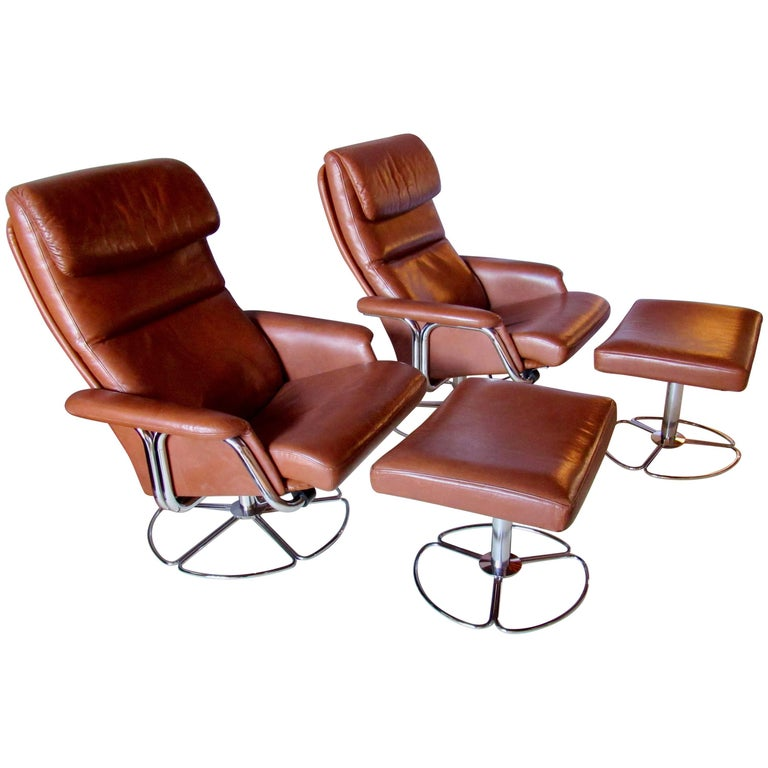 Bruno Mathsson DUX Leather and Chrome Swivel Lounge Chairs and Ottomans 1970s