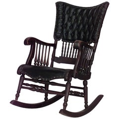 American Victorian Oak & Black Tufted Leather Rocking Chair with Spindle Design