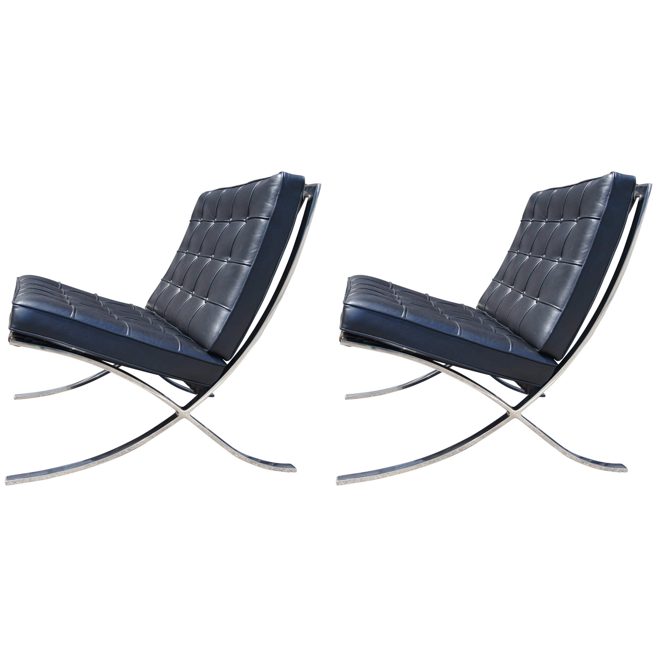 Pair Of Black Leather Barcelona Chairs By Mies Van Der Rohe For