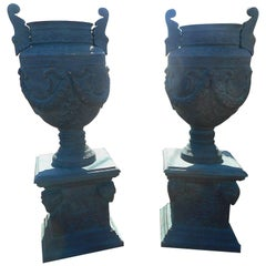 Massive Pair of Cast Iron Urns on Pedestal Bases
