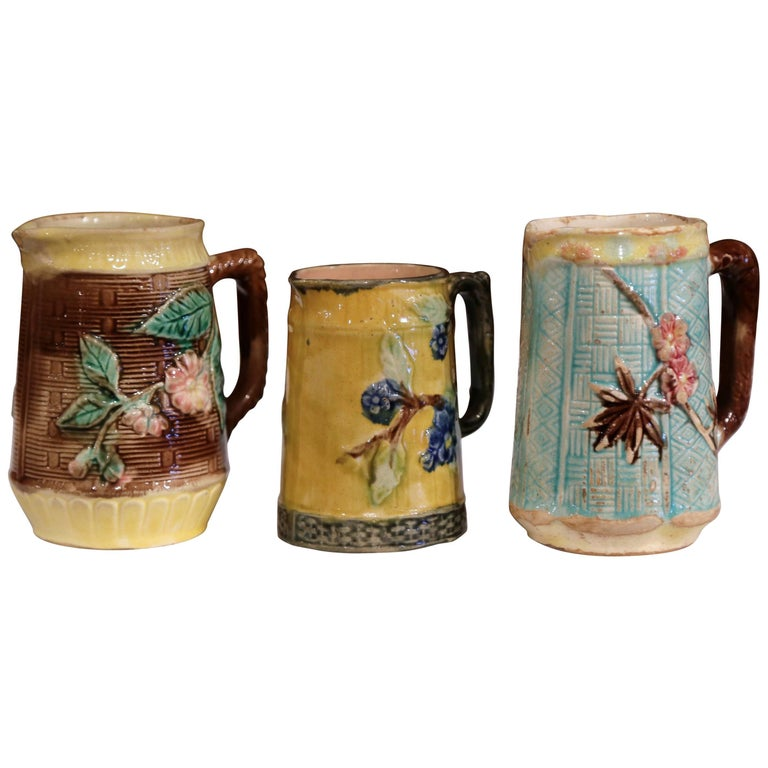 Set of Three French 19th Century Hand-Painted Ceramic Barbotine Pitchers For Sale