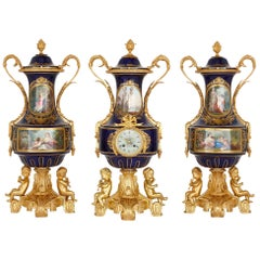 Antique Rococo Style Porcelain and Gilt Bronze Clock Garniture