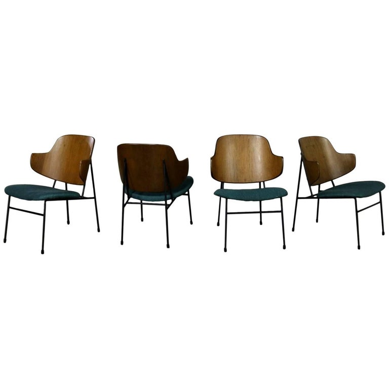 Set of Four Ib Kofod-Larsen Penguin Chairs Walnut Molded Backs Turquoise Seats