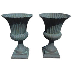 Pair of Large Cast Iron Urns
