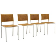 Four Steel Frame Dining Chairs by George Nelson, White Frames, Cane Seats/Backs
