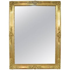 19th Century Louis XV Style Large Gilded Mirror with Carved Details