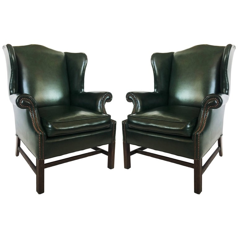 Pair of Chesterfield Tufted Dark Green Leather Wingback Chairs