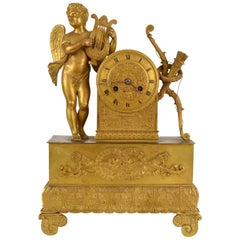 French Empire Ormolu Mantel Clock Figural Amour Playing Lyre, circa 1820