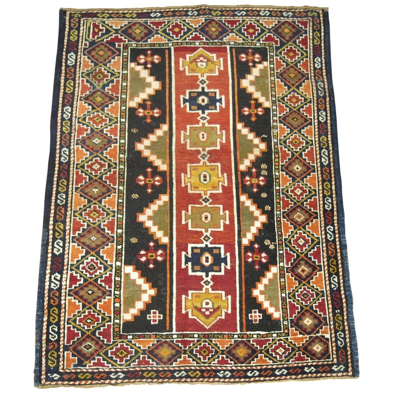 Rare small square compact size early 20th century antique Caucasian Shirvan rug.