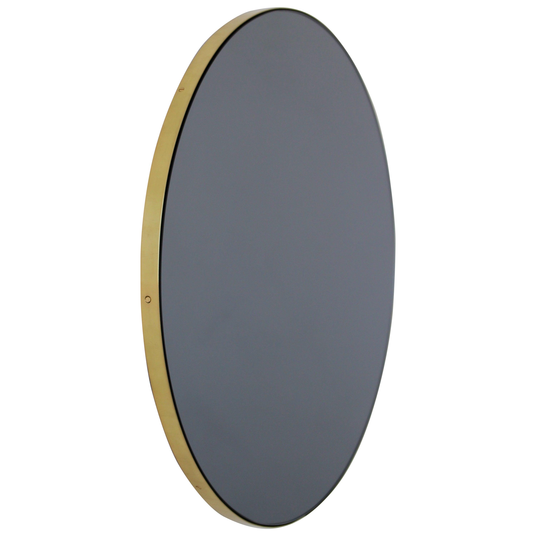 Orbis™ Black Tinted Round Contemporary Mirror with a Brass Frame - Medium