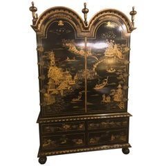 Palatial Chinoiserie Decorated Ebonized Two-Door over Four Drawer Armoire