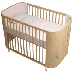 Embrace Luck Crib in Beechwood and Cotton Candy Pink by MISK Nursery
