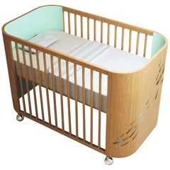 Embrace Luck Crib in Beech Wood and Light Celadon Green by Misk Nursery