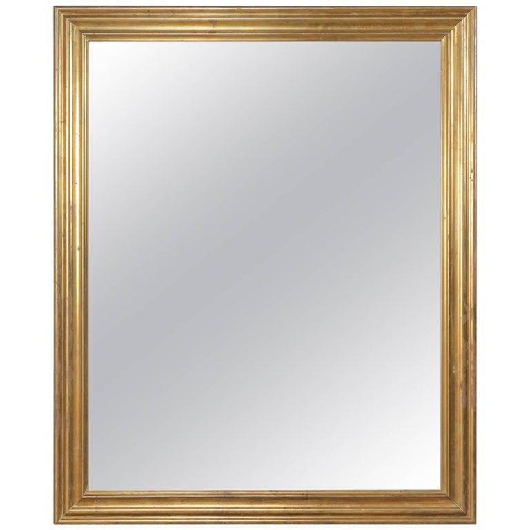 Elegant French Mid-20th Century Mirror with Brass Surround