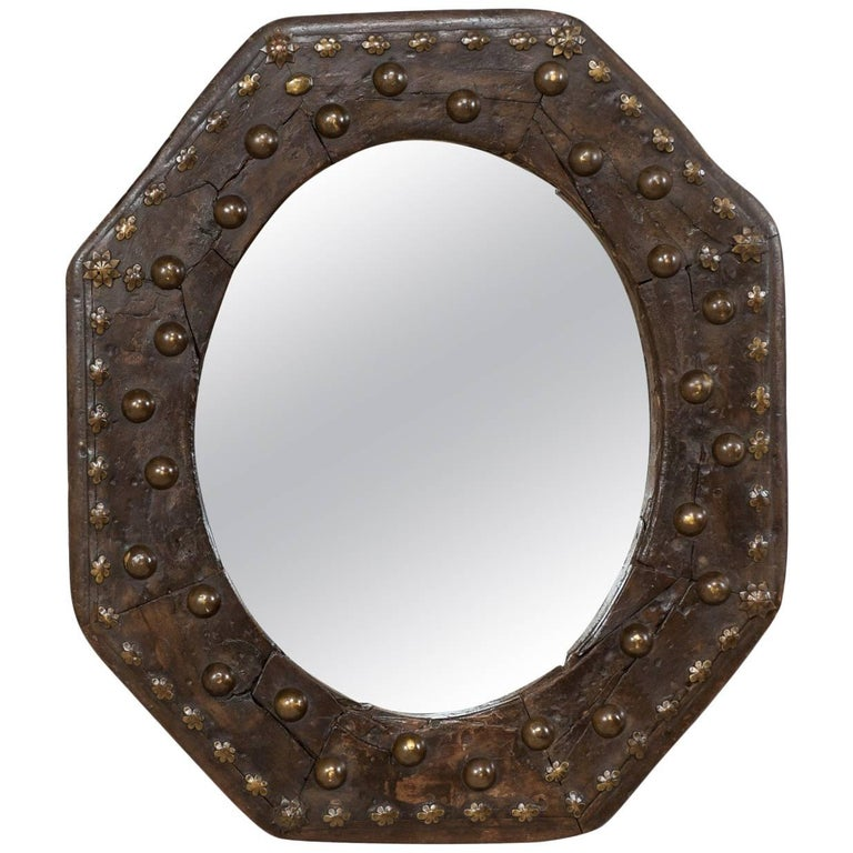 Spanish 19th Century Octagonal Wood Mirror with Flower Accents and Nail Heads
