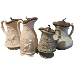 Lot of Four Pewter Top Relief Pitchers