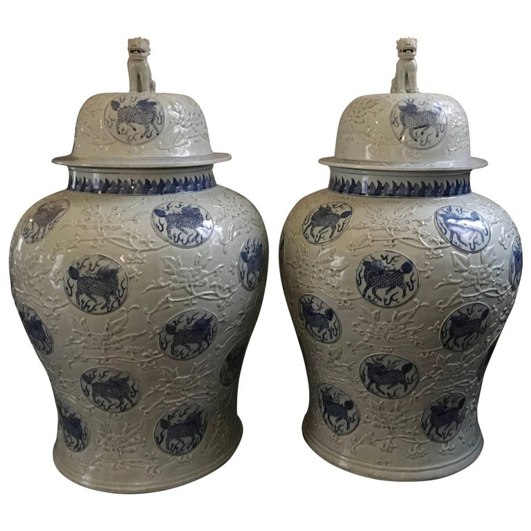 Midcentury Pair of Chinese Porcelain Glazed Blu and White Poo Dogs Jant Jars