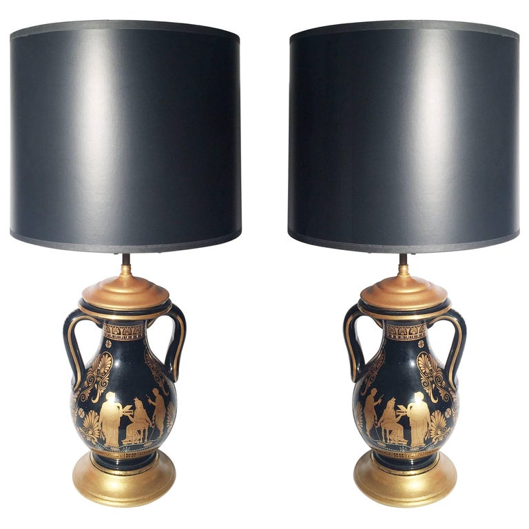 Pair of Black and Gilt Neoclassical Urn Lamps For Sale