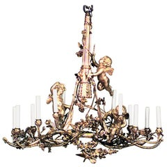 Gilt Bronze And Cut Crystal Twelve Light Chandelier By E