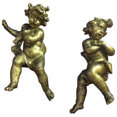 Pair of 17th Century Italian Baroque Giltwood Putti Figures