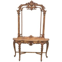 Renaissance Style Carved and Gilded Walnut Pier Mirror and Console Table