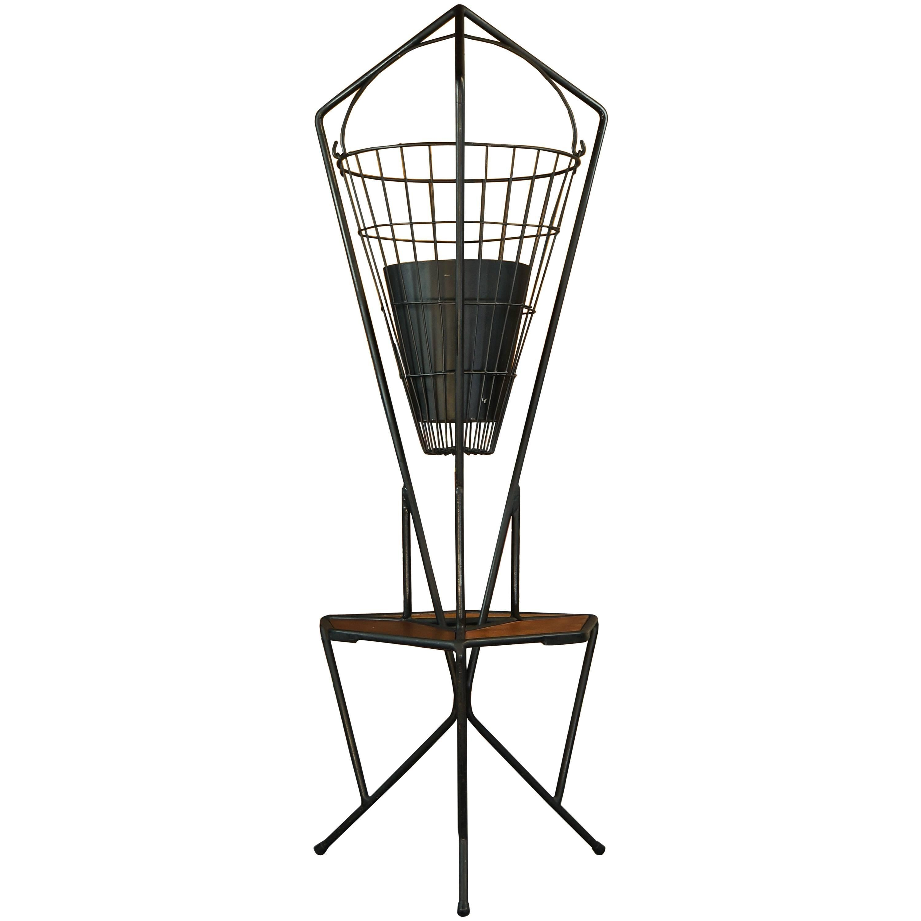 midcentury vintage 1960s iron and teak hanging planter plant stand Mercury Milan Hood midcentury vintage 1960s iron and teak hanging planter plant stand side table for sale at 1stdibs