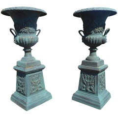 Pair of Cast Iron Urns on Pedestal Bases