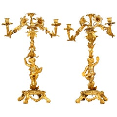 Pair of French Louis XV Style Bronze Dore Cupid Base Candelabra