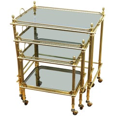 Maison Bagues Nesting Tables in Brass and Smoked Glass on Casters