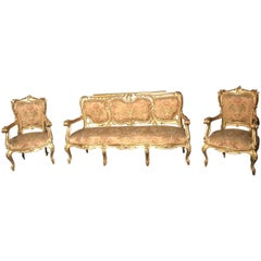 Italian 19th Century Gilt Living Room Suite with a Sofà and Pair of Armchairs