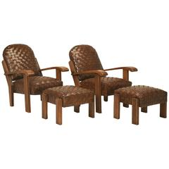 Style French Woven Leather Club Chairs with Matching Ottomans, circa 1920
