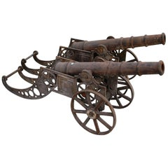 Pair of Cast Iron Cannon on Wheels Reproductions