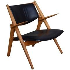 Hans J. Wegner CH28 Sawbuck Lounge Chair, Denmark, circa 1950