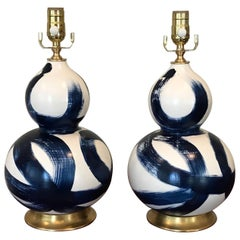 Small Pair of Blue and White Ceramic Double Gourd Shape Lamps on Gilt Bases