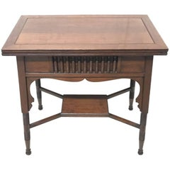 Liberty & Co. an Anglo-Moorish Arts & Crafts Walnut Fold over Card & Games Table