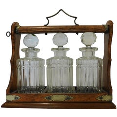 Victorian Oak and Silver Metal Tantalus with Crystal Decanters