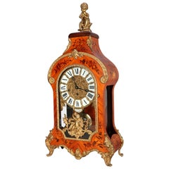 French Louis IV Style Inlaid Kingwood and Ormolu Figural Bracket Clock