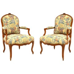 Pair of French Provincial Louis XV Open Armchairs