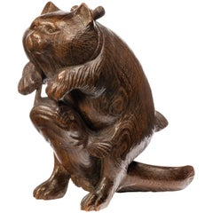 Carved Japanese Figure of a Cat Playing with a Dogfish