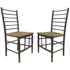Liberty and Co, A Pair of Arts and Crafts Side Chairs with Finely Rushed Seats