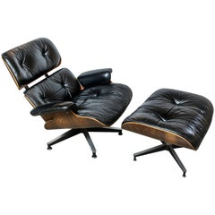 Original Rosewood Eames Lounge Chair and Ottoman in Black Leather