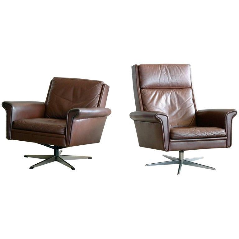Pair of Danish High Low Swivel Lounge Chairs in Chocolate Leather by Georg Thams