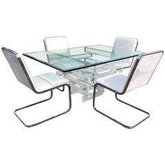 Hollywood Regency Lucite and Glass Dining Table with Four Chrome Chairs