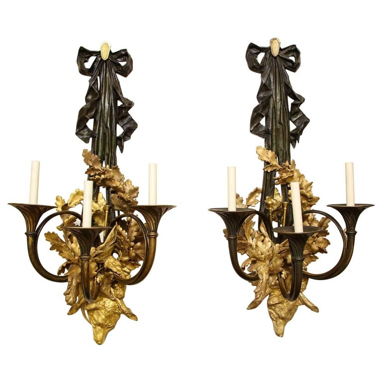 Pair of Neoclassical Ormolu and Black-Painted Three-Light Sconce For Sale
