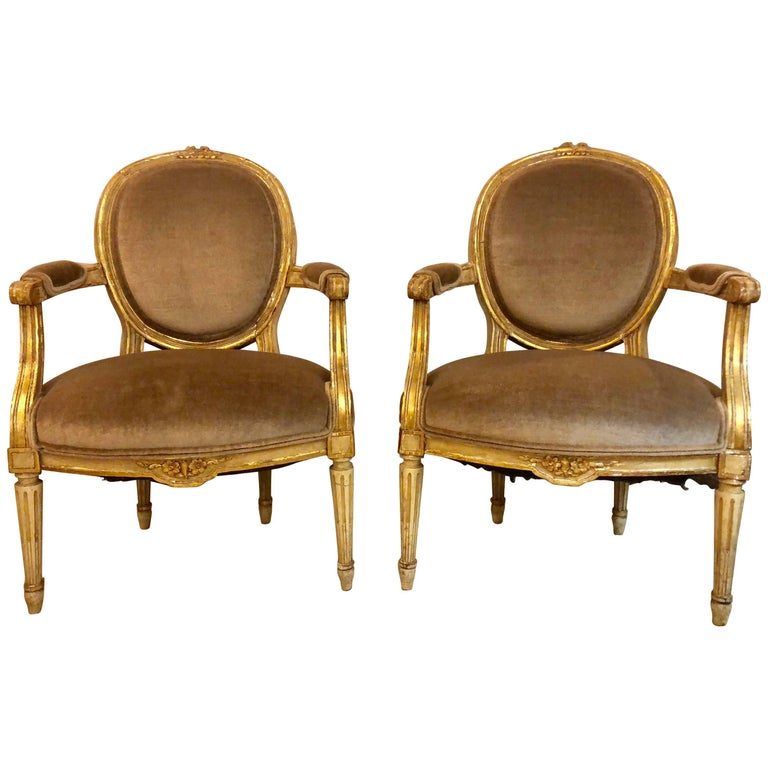 Pair of Gilt Gold Paint Decorated & Carved Louis XVI Style Armchairs or Fauteuil